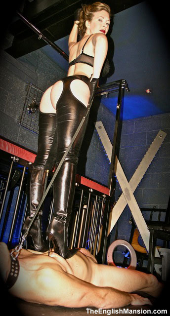 Mistress T trampling in sexy boots.