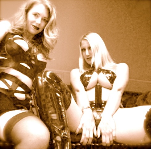 Nikki Whiplash (see her strap-on cock?) & Mistress T...getting ready to film.