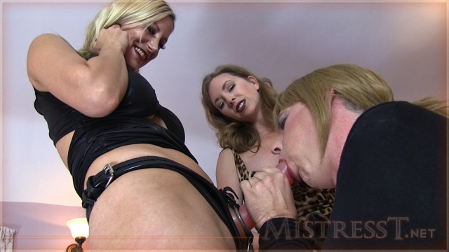 Nikki Whiplash & Mistress T training a trannie to suck cock...