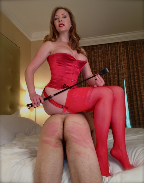 Mistress T, corporal punishment in a corset & stockings.