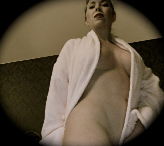 Mistress T in a bath robe.