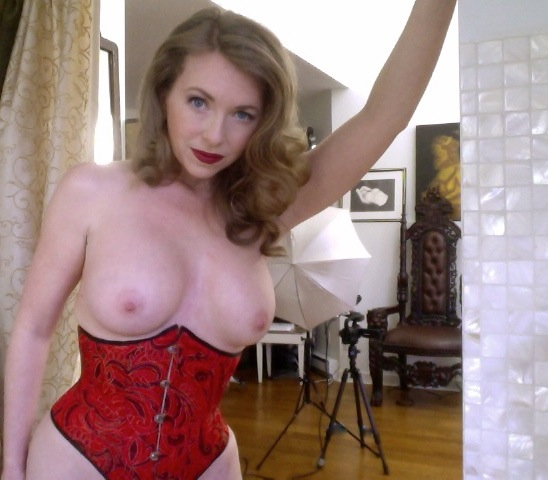 Mistress T in a red corset.