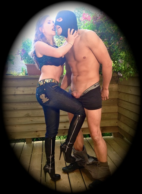 Mistress T kneeing a lucky slave in the nuts.