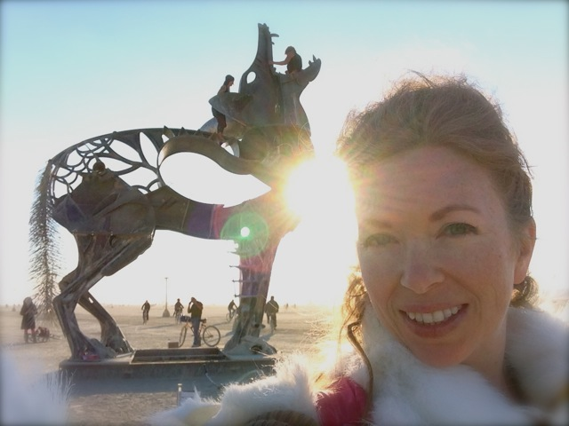 Mistress T in front of iron wolf at Burning Man 2013.