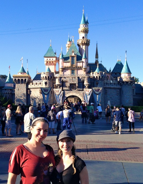 Domina Snow & I in front of the castle at Disney.